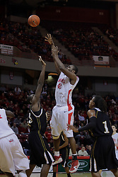 22 December 2009: Dinma Odiakosa shoots over top of David Thomas. The Tigers of Grambling State are defeated by the Redbirds of Illinois State 80-56 on Doug Collins Court inside Redbird Arena in Normal Illinois.