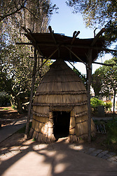 California: San Francisco. Mission Dolores, Indian tule house in garden. Photo copyright Lee Foster. Photo #: 26-casanf78526