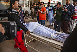 October 5, 2018 - Srinagar, Jammu and Kashmir, India - Neighbors and relatives carry the shroud covered body of one of the members of the regions oldest pro India political party, the National conference after he was killed by unidentified gunmen, on October 5, 2018 in Srinagar, the summer capital of Indian administered Kashmir, India.Two members of the regions oldest pro India political party, the National conference (NC), were shot dead while another was wounded by unidentified assailants in Karfali Mohalla area of summer capital city Srinagar. Local news agency reported that the militants attacked the close aides of NC Member Legislative Assembly for Habba Kadal constituency Shimami Firdous at Karfali Mohalla. The slain were identified as Mushtaq Ahmad Wani and Nazir Ahmed Wani. India has announced local body polls in the region from October 8 but major pro Indian parties Including the NC have  decided to boycott  the polls over what they term New Delhi's attempt to alter the demography of the disputed Himalyan region  (Credit Image: © Yawar Nazir/ZUMA Wire)