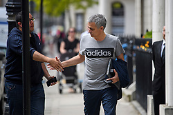 © Licensed to London News Pictures. 27/05/2016. London, UK.  JOSE MOURINHO shakes the hand of Portuguese Man U fan, STEVEN RIBEIRO, as he returns to  his home in west London on the day he was officially announced as the new manager of Manchester United Football Club. Photo credit: Ben Cawthra/LNP