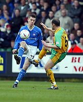Photo:Scott Heavey<br />Norwich City V Ipswich Town. 02/03/03.<br />A tackle on Darren Ambrose by Craig Flemming forces Ambrose to leave the pitch being sick during this Nationwide division 1 match.