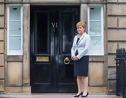 First Minister Nicola Sturgeon waiting for Boris Johnson to arrive at Bute House.
