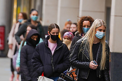 © Licensed to London News Pictures 28/10/2020. Nottingham  , UK. Shoppers wearing face masks wait to enter a shop in the city centre before new restrictions come into force in Nottingham. The county of Nottinghamshire will enter into Tier 3 ,from 00:01 am on Friday 30 October.  Photo credit: Ioannis Alexopoulos/LNP