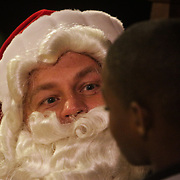 Santa Claus talks to Kshaun Williams, 9, during the Greenfield Christmas Tree lighting at Greenfield Lake Park Thursday December 4, 2014 in Wilmington, N.C. (Jason A. Frizzelle)