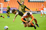 Bristol Rovers Defender Jack Baldwin (26) challenges with Blackpool forward Keshi Anderson (8) during the EFL Sky Bet League 1 match between Blackpool and Bristol Rovers at Bloomfield Road, Blackpool, England on 9 May 2021.