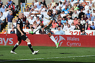Swansea city's Ashley Williams heads just wide of goal. Barclays Premier league, Swansea city v Fulham at the Liberty Stadium in Swansea, South Wales on Sunday 19th May 2013. pic by Andrew Orchard,  Andrew Orchard sports photography,