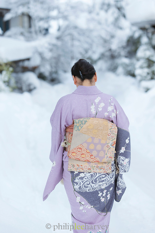 Japanese woman wearing traditional kimono walking in snow, Shirakawa-go, Japan