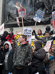 © under license to London News Pictures. 30/11/2010. Students march in London for the third time to protest against the raising of tuition fees. Demonstrators burn placards on Nelsons Column.  Credit should read Matt Cetti-Roberts/London News Pictures