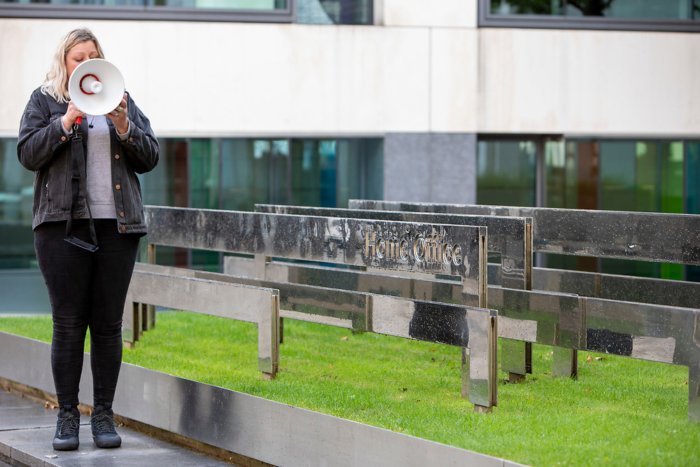 Maddie Harris of Humans For Rights Network reading out the words of a former resident of Napier Barracks describing conditions at a Close Napier Barracks demonstration outside the Home Office headquarters on Marsham street, London, United Kingdom on the 28th September 2021. Napier Barracks has been used by the Home Office to house Asylum seekers for a year now. Close the Camps organised a solidarity demo for the people in Napier Barracks, there have been numerous calls for the camp to close as the facilities have been deemed unsafe for habitation and unfit for purpose. (photo by Andrew Aitchison / In Pictures via Getty Images)