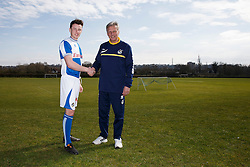 Bristol Rovers Manager John Ward shakes hands with Ollie Clarke as the player signs a new contract with the club - Photo mandatory by-line: Rogan Thomson/JMP - 07966 386802 - 17/03/2014 - SPORT - FOOTBALL - Friends Life Sports Ground, Bristol - Bristol Rovers Player Signing at the training ground.