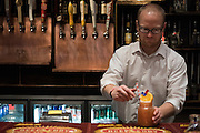 """Nate Plumb makes a """"Booz Cruz"""" cocktail at The Rustic during a Super Tuesday watch party on March 1, 2016 in Dallas, Texas.  (Cooper Neill for The New York Times)"""