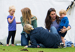© Licensed to London News Pictures. 14/06/2015. Prince George of Cambridge and his mother Catherine Duchess of Cambridge talking to Autumn Phillips (second left)  and Daughter Savannah Phillips, with Zara Phillips (front) . British Royals attend a charity Polo match in Tetbury,  Gloucestershire, UK. Photo credit: Ben Cawthra/LNP