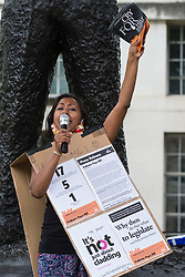London, UK. 15th July, 2021. Deepa Mistry of Building Safety Crisis addresses a protest opposite Downing Street by fellow leaseholders and tenants living in unsafe homes. Some leaseholders are faced with crippling costs to fix safety issues and they called on the government to ensure that their homes are made safe from fire as a matter of priority, to make interim payments and cover fire safety remediation costs and to find a solution with mortgage lenders.