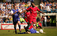 Photo:  Frances Leader.<br /> Gillingham FC v Cardiff City FC. Coca Cola Championship. <br /> Priestfield Stadium<br /> 30/04/05<br /> Cardiff's Cameron Jerome is tackled by Gillingham's Jonathan Douglas(player at left is Michael Flynn).