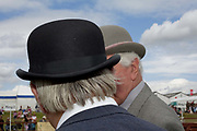 Tom Alty, commentator and judge of Bartle, Lancashire chats about the quality of the pigs with a fellow judge, Stan Samuels. 'Showing pigs is a performance because you don't have a halter and rope or bridle, you just have a bat [a stick] and a board. You have to have an empathy between pig and handler, but even the good pigs are not as obedient as you'd like. At one show about 15 years ago I asked my wife, who had never taken an animal in the ring, to walk round an old Large Black sow. It was a placid pig, but suddenly there was a grunt and a rush, and the pig disappeared into the horticultural tent, which housed, among other things, a display of eggs. My wife has never been to a show since.'