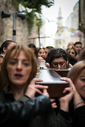 19 April 2019, Jerusalem: Members of the Latin Patriarchate of Jeruslame carry a wooden cross through the Jerusalem Old City. Thousands of Christians march the Via Dolorosa on Good Friday, marking the stations of the cross in the Jerusalem Old City, in memory of the path Jesus walked carrying his cross towards his crucifixion.