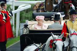 © London News Pictures. 18/06/2013. Ascot, UK.   HRH Queen Elizabeth II arrives in a carriage for day one of Royal Ascot at Ascot racecourse in Berkshire, on June 18, 2013.  The 5 day showcase event,  which is one of the highlights of the racing calendar, has been held at the famous Berkshire course since 1711 and tradition is a hallmark of the meeting. Top hats and tails remain compulsory in parts of the course. Photo credit should read: Ben Cawthra/LNP
