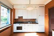 House kitchen to be renovated white with strong contrasts. Nobody inside.
