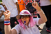 """09 MAY 2014 - BANGKOK, THAILAND: Thai anti-government protestors cheer for Suthep Thaugsuban in Lumpini Park Friday. Thousands of Thai anti-government protestors took to the streets of Bangkok Friday to start their """"final push"""" to bring the popularly elected of government of Yingluck Shinawatra. Yingluck has already been forced out by a recent court ruling that forced her to resign and she is facing indictment by the National Anti Corruption Commission of Thailand for alleged improprieties related to a government rice price support scheme. The protestors Friday were marching to demand that she not be allowed to return to politics. The courts have not banned her party, Pheu Thai, which has formed an interim caretaker government to govern until elections expected in July, 2014. Suthep Thaugsuban, secretary-general of the People's Democratic Reform Committee (PDRC),  said the president of the Supreme Court and the new senate speaker, who would be selected Friday, should set up an """"interim people's government and legislative assembly."""" He went onto say that if they didn't, he would.     PHOTO BY JACK KURTZ"""