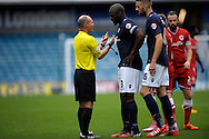 Captain Danny Shittu of Millwall and Mark Beevers of Millwall having a discussion with Match Referee Scott Duncan for a foul award to Cardiff City. Skybet football league championship match , Millwall v Cardiff city at the Den in Millwall, London on Saturday 25th October 2014.<br /> pic by John Patrick Fletcher, Andrew Orchard sports photography.