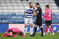 Football - 2020 / 20-21 Sky Bet Championship - Queens Park Rangers vs Derby County - Kiyan Prince Foundation Stadium<br /> <br /> Geoff Cameron of Queens Park Rangers is shown a yellow card by Referee Tim Robinson.<br /> <br /> COLORSPORT