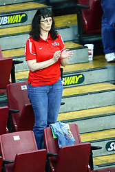 13 September 2011: Redbird Volleyball fan stands to cheer on the set point during an NCAA volleyball match between the Ramblers of Loyola and the Illinois State Redbirds at Redbird Arena in Normal Illinois.