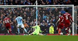 Manchester City's Gabriel Jesus (second left) scores his side's first goal of the game during the UEFA Champions League, Quarter Final at the Etihad Stadium, Manchester.