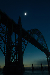 The sun reaches totality over the Yaquina Bay Bridge in Newport, Oregon. (Andy Nelson/The Register-Guard)