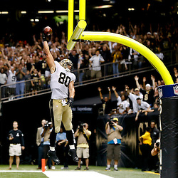 Sep 22, 2013; New Orleans, LA, USA; New Orleans Saints tight end Jimmy Graham (80) celebrates a touchdown catch against the Arizona Cardinals during the second half of a game at Mercedes-Benz Superdome. The Saints defeated the Cardinals 31-7. Mandatory Credit: Derick E. Hingle-USA TODAY Sports