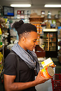 Brooklyn, NY - September 21, 2018: Chef Michael Adé Elégbèdé shops for ingredients for his upcoming James Beard House dinner at Keita, an African Market in Bushwick.<br /> <br /> Photo by Clay Williams for The James Beard Foundation.<br /> <br /> © Clay Williams / http://claywilliamsphoto.com