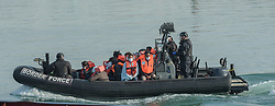 © Licensed to London News Pictures. 06/09/2021. Dover, UK. Migrants arrive at Dover Harbour in Kent on a Border Force boat after crossing the English Channel. Fine weather is expected to see migrants attempt to cross the English Channel to the UK this week.  Photo credit: Stuart Brock/LNP