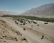 Donkeys and men trekking between Yamchun village and Darshai. Sights and places to see while walking along the Tajikistan side of the Wakhan Corridor.