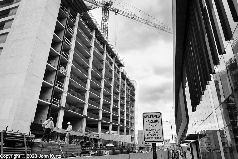 """01 OCTOBER 2020 - DES MOINES, IOWA:  Construction work on a mixed use building in downtown Des Moines. The project is supposed to include residential units, offices, a hotel, restaurants and bars, and a movie theater. The city of Des Moines filed a notice of default in June and the bank foreclosed on the property on September 14. The developer said the """"pandemic has created an environment where few are thinking about high-rises and bold projects like this one."""" The economy in downtown Des Moines is still feeling the affects of the COVID-19 shutdown ordered in March. Seven months after the shutdown, employers still have their workers working from home. Restaurants, barbershops, and retail are feeling the impact. Many have closed or cut back on workers and hours.       PHOTO BY JACK KURTZ"""