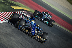 March 7, 2017 - MARCUS ERICSSON (SWE) drives on the track in his Sauber C36-Ferrari followed by LEWIS HAMILTON (GBR) of team Mercedes during day 5 of Formula One testing at Circuit de Catalunya (Credit Image: © Matthias Oesterle via ZUMA Wire)