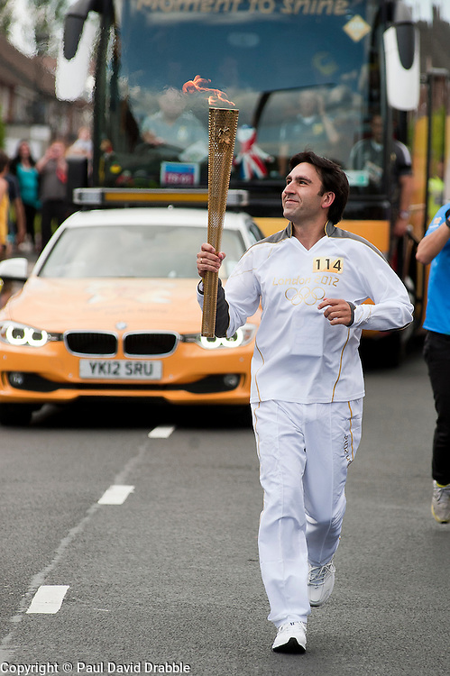 The Olympic Torch relay reaches Sheffield on day 38 coverage from the Chapeltown - Ecclesfield - Parson Cross section of the Journey.<br /> Olympic Torch Bearer 114 Benjamin Perez<br /> 25 June 2012.Image © Paul David Drabble