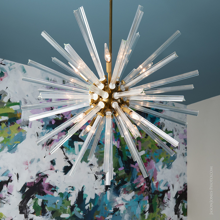 Modern Chandelier with bold wallpaper background in multifamily community area. Texas Architectural Photographer, Dallas.