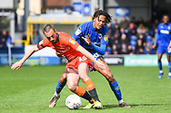 Wycombe Wanderers Defender Michael Harriman (16) and AFC Wimbledon Defender Toby Sibbick (20) in action during the EFL Sky Bet League 1 match between AFC Wimbledon and Wycombe Wanderers at the Cherry Red Records Stadium, Kingston, England on 27 April 2019.