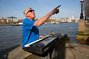 Busker playing an electronic organ singing at the riverside. This busking regular sings old classic pop songs and always engages his audience with his cockney banter. The South Bank is a significant arts and entertainment district, and home to an endless list of activities for Londoners, visitors and tourists alike.