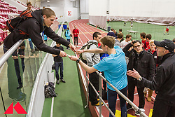 Galen Rupp signs autographs for fans after he sets American record in 2-Mile at BU Terrier
