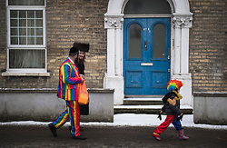 © Licensed to London News Pictures. 01/03/2018. London, UK. An orthodox Jewish boy and his father, both in fancy dress, celebrate the festival of Purim on the streets of Stamford Hill in north London on March 1, 2018. Purim celebrates the miraculous salvation of the Jews from a genocidal plot in ancient Persia, an event documented in the Book of Esther. Traditionally the jewish community wear fancy dress and exchange reciprocal gifts of food and drink. Photo credit: Ben Cawthra/LNP