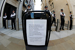 © Licensed to London News Pictures. 15/10/2011, London, UK.  A notice  declaring Paternoster Square in the City of London closed to public as police officers prevent protesters from occupying the square to demonstrate outside the London Stock Exchange against corporate greed, Saturday, Oct. 15, 2011. Photo credit : Sang Tan/LNP