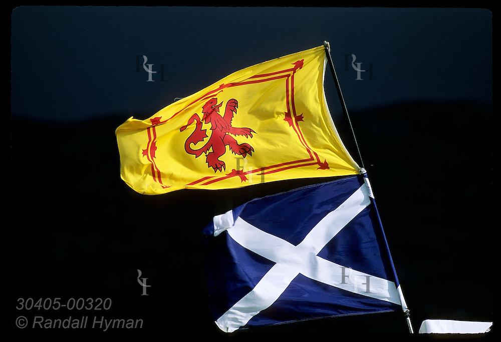 Royal 'rampart lion' flag flies above Scottish national flag at Highland Games in Fort Augustus, Scotland.