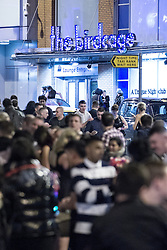 """© Licensed to London News Pictures . 15/12/2012 . Manchester , UK . Busy streets . Revellers enjoy a wet but busy night out on one of the last weekends before Christmas , a traditionally busy time when office parties and clubbers decent on bars and clubs , often known as """" Mad Friday """" . Photo credit : Joel Goodman/LNP"""