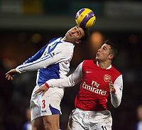 Photo: Paul Thomas.<br /> Blackburn Rovers v Arsenal. The Barclays Premiership. 13/01/2007.<br /> <br /> Robin van Persie (R) of Arsenal is beaten to the ball by Zurab Khizanishvili.
