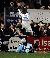 Photo: Richard Lane.<br />Wycombe Wanderers v Chelsea. Carling Cup, Semi Final 1st Leg. 10/01/2007. <br />Chelsea's Geremi is challenged by Wycombe's Stephen O'Halloran.
