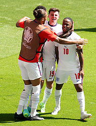 England's Raheem Sterling (right) celebrates scoring their side's first goal of the game with team-mates during the UEFA Euro 2020 Group D match at Wembley Stadium, London. Picture date: Sunday June 13, 2021.
