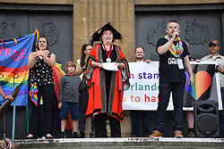 Marion Maxwell, Lord Mayor, with Andy Futter, Chair of Norwich Pride, speaking with signer, Norwich Pride 30 July 2016 UK