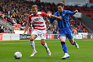 Herbie Kane of Doncaster Rovers (15) breaks past Alex Lacey of Gillingham (4) during the EFL Sky Bet League 1 match between Doncaster Rovers and Gillingham at the Keepmoat Stadium, Doncaster, England on 20 October 2018.