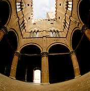 Wide angle view of the Torre del Mangia and the Palazzo Pubblico courtyard, Siena, Tuscany, Italy