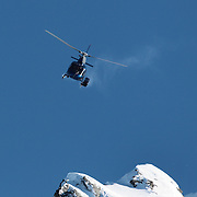A helicopter transports athletes during the World Heli Challenge Extreme Day at Mount Albert on Minaret Station, Wanaka, New Zealand. 1st August 2011